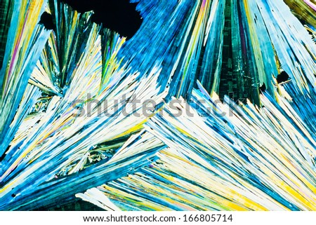Colorful appearance of crystals of urea or carbamid, a powerful nitrogen fertilizer for agricultural use, in polarized light. - stock photo