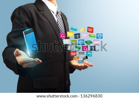 colorful application icon with mobile phone in the hands of businessmen, Business software and social media networking service concept - stock photo