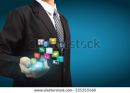 Colorful application icons with Hand holding the mobile phone - stock photo