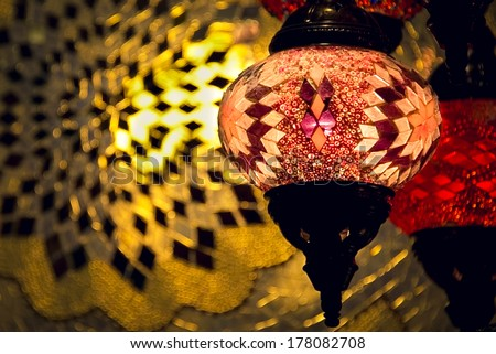 Colorful arabic lamp with bright light in background. Concept for arabic, islamic culture and design. - stock photo
