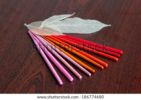 Colorful aroma  sticks (pink, orange and red colors) - stock photo