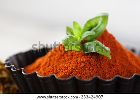 Colorful aromatic spices and herbs on old wooden background, selective focus