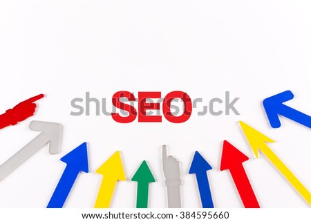 Colorful Arrows Showing to Center with a word SEO - stock photo