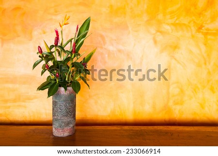 Colorful Artificial Flower on yellow background, - stock photo