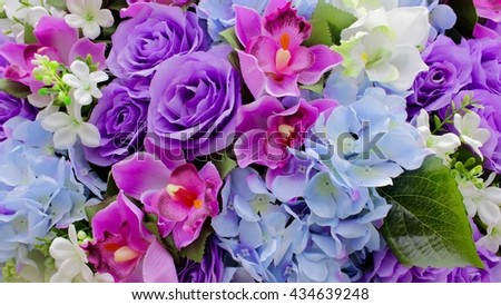 Colorful artificial flowers background
