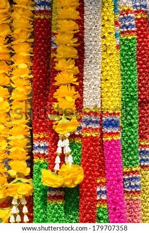 Colorful artificial garland for Buddhism worship - stock photo