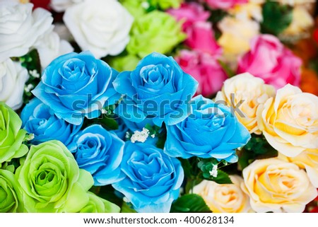 colorful artificial rose branch - stock photo