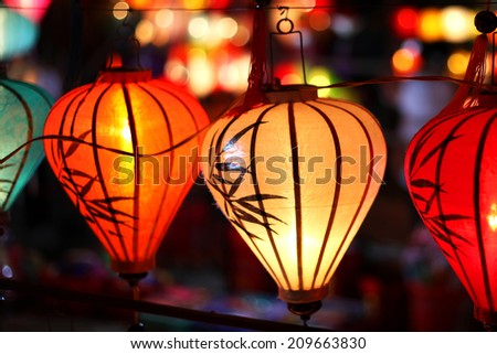 Colorful Asian paper lanterns at night - stock photo