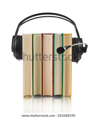 colorful audio book concept with headphones and books  - stock photo