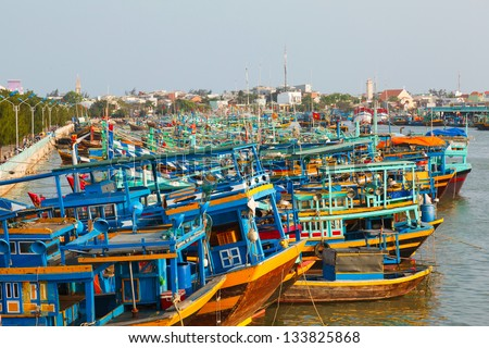 colorful authentic Fishing boats in the bay in Vietnam against the blue sky