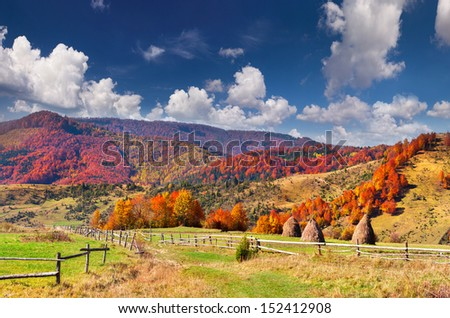 Colorful autumn landscape in the mountain village - stock photo