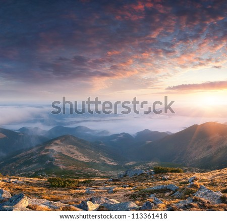 Colorful autumn landscape in the mountains. Sunrise - stock photo