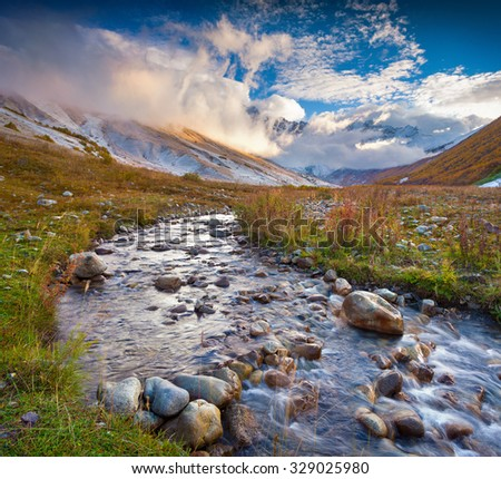 Colorful autumn morning in the Caucasus mountains with a pure mountain creek. Ushguli location, Upper Svaneti, Georgia, Europe. October 2015. - stock photo