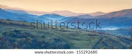 Colorful autumn panorama of the mountains. Sunrise - stock photo