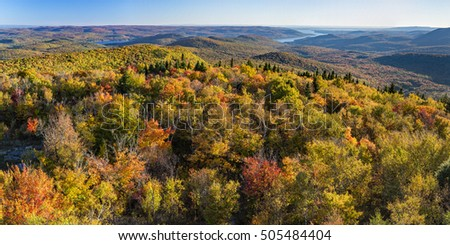 Colorful Autumn panoramic view south over West Mountain and the Great Sacandaga Lake from the Hadley Mountain fire tower in the Adirondack Mountains of New York