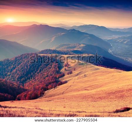 Colorful autumn sunrise in the Carpathian mountains. Krasna ridge, Ukraine, Europe. - stock photo