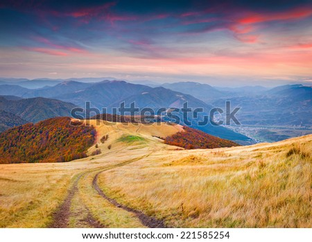 Colorful autumn sunrise in the mountains. - stock photo
