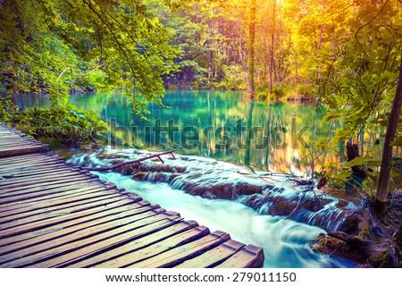 Colorful autumn sunrise in the Plitvice Lakes National Park. Croatia. Europe. Lomography stylization and instagram toning effect. - stock photo