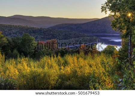 Colorful Autumn sunset on the Pepacton Reservoir seen from the Shaverton Trail in Andes in the Catskills Mountains of New York.