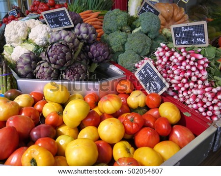 Colorful autumn vegetables on display in a grocery shop in France