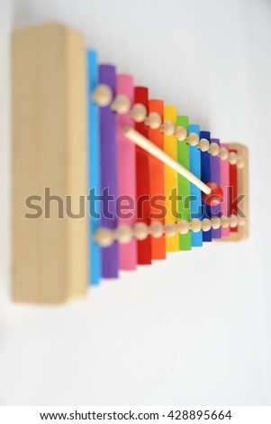 Colorful baby xylophone with stick isolated over white background - stock photo