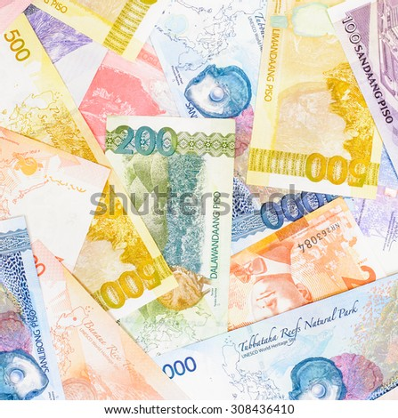 Colorful background and texture of Philippines currency - stock photo