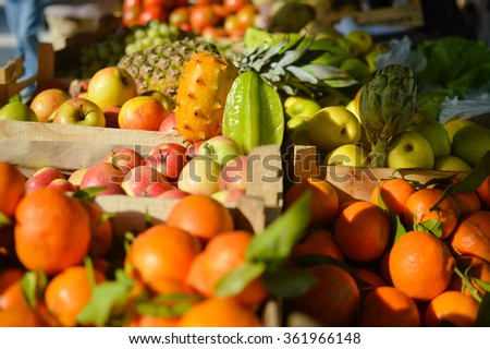 Colorful background from many different fruits at a farmers market - stock photo