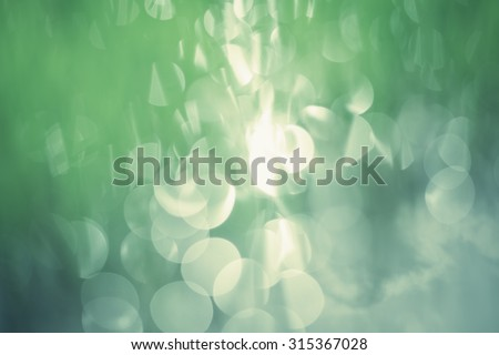 Colorful background in green colors. The Bokeh effect created by mother nature, rice crops shadow reflect on water. - stock photo
