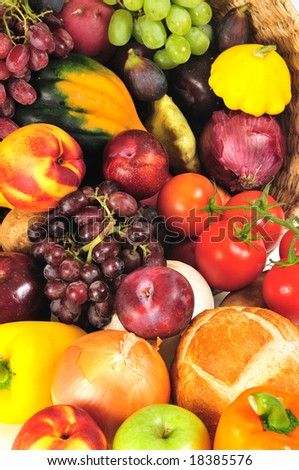 Colorful background of holiday harvest foods in a basket - stock photo