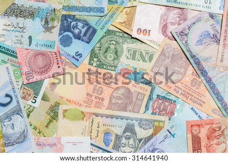 Colorful background of many currency banknotes from many country - stock photo