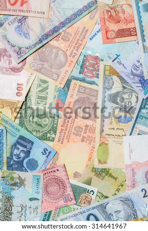 Colorful background of many currency banknotes from many country
