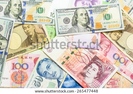 Colorful background of many currency,money profit from business with many country - stock photo