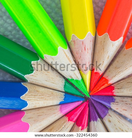 Colorful background of stacked wooden pencil.