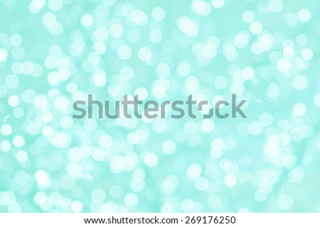 Colorful background with natural bokeh texture and defocused sparkling lights. Turquoise and pink texture with background with twinkling lights. Vintage and pastel colors - stock photo
