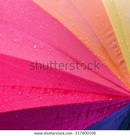 Colorful background with water trapped on the surface. - stock photo