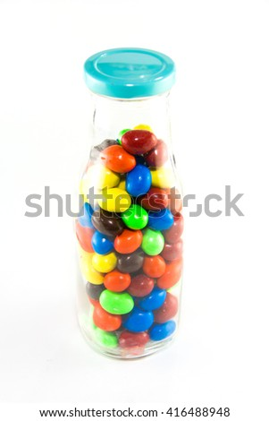 colorful ball chocolate candy in glass jar - stock photo