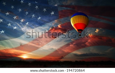 Colorful balloon flying at sunrise on the background of the USA flag - stock photo
