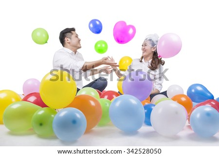 Colorful Balloon in Pre-Wedding of Young Asian Couple in Studio