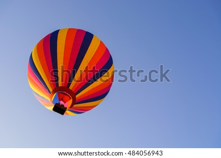 Colorful balloon on blue sky.