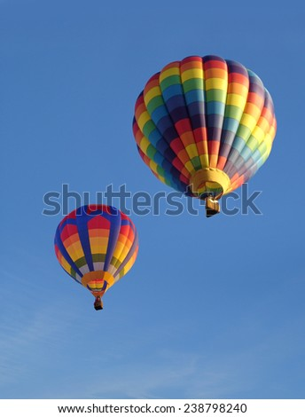 Colorful balloons against a blue sky. Portrait photo ideal for use as a cover. - stock photo