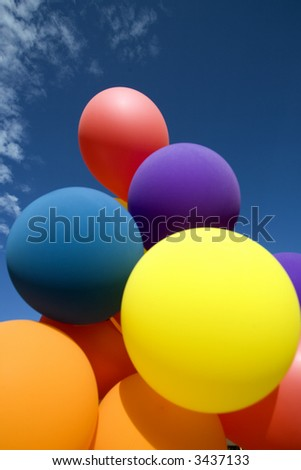 colorful balloons against blue sky - stock photo