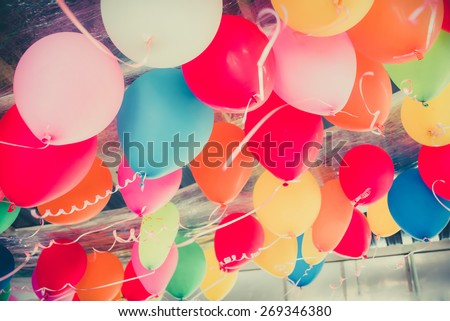 Colorful balloons floating on the ceiling of a party in childhood memory - stock photo