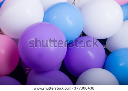 colorful balloons in a bunch: white, purple, pink and blue - stock photo