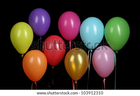 colorful balloons isolated on black background