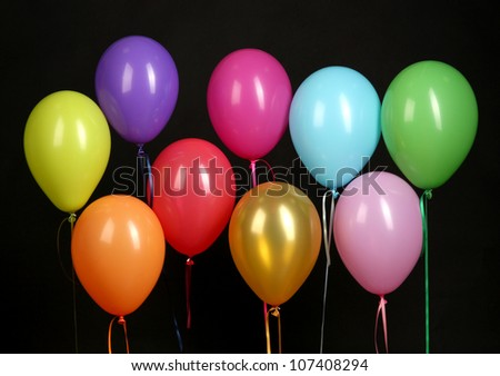 colorful balloons isolated on black background - stock photo