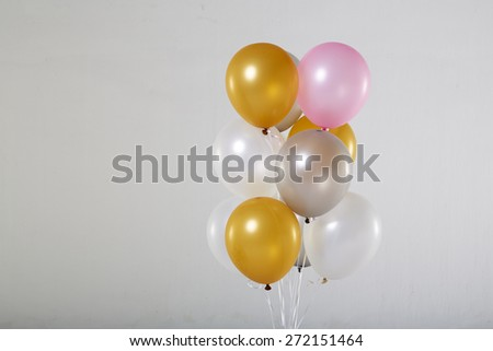Colorful balloons on a gray background.