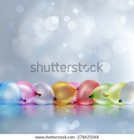 colorful balloons on light blur background - festive background - stock photo
