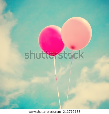 Colorful balloons over retro vintage background - stock photo