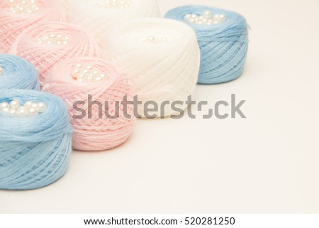 colorful balls of yarn on a light background