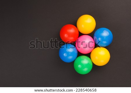 Colorful balls on a black background - stock photo